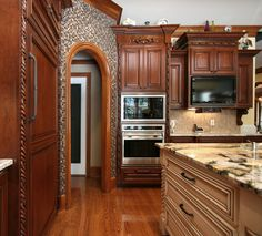 A Very Large Kitchen With Two Islands For Plenty Of Work