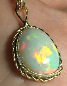 15.5 Carat Gorgeous Colorful Welo Opal Gem Pendant set in Mixed Gold and Silver