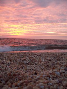 """if you've never been, go to Cape May, New Jersey. search the pebbles on Sunset Beach (a.k.a. the """"Pebble Beach"""" ) and search for a Cape May diamond. if you don't find one at least you will see an amazing sunset."""