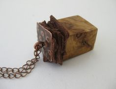 Olive wood and copper pendant on a metal chain. by Stelakastela