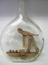 Folk Art Whimsy In A Bottle - Carved Bocce Ball Player