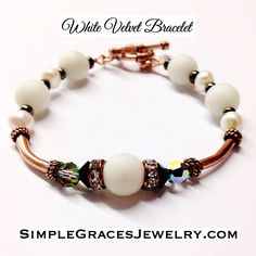 This unique bracelet of matte jade stones, white fresh water pearls, copper and Swarovski Crystal adds styles to any attire. Crystal Jewelry, Crystal Necklace, Unique Bracelets, Beaded Bracelets, 15th Wedding Anniversary Gift, Freshwater Pearl Bracelet, White Velvet, Jade Stone, Pearl White