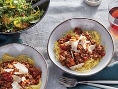 We swap traditional pasta for gluten-free spaghetti squash in this meatless main. Roasted until tender and scraped with a fork, the squash comes apart in noodle-like strands that hold the sauce well. Roast an extra squash, scrape out the flesh, and store in ziplock plastic bags for a quick side during the week. A blend of mushrooms—dried porcini and fresh cremini and button—mimic the texture of ground beef while adding plenty of savory depth. You could substitute 1/4 cup of the canned tomato…