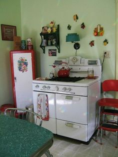 kitchen - love that vintage stove, red metal stool, and a sweet little red jam or pie locker, in the corner Cozy Kitchen, Red Kitchen, Vintage Kitchen, Kitchen Decor, 1950s Kitchen, Kitchen Things, 1950s Decor, Vintage Decor, 50s Vintage