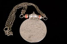Protective amulet with the Throne Verse. On the other side, a stylized demon is engraved,Oman.