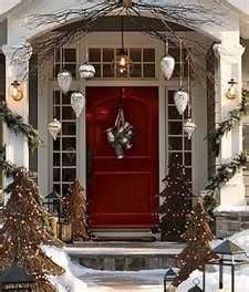 Hang large outdoor ornaments in entry way for Christmas - wrap lights & possibly garland around columns & door