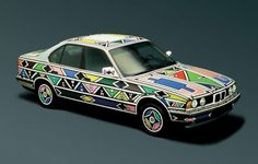 BMW Art Car: 1991 BMW The Art Car was the first to have been signed by a woman. This is not the only fact that makes this BMW so special. The South African artist Esther Mahlangu coa… Bmw 525i, Bmw E34, Diesel, Contemporary African Art, New York Museums, South African Artists, Afro Art, Car Painting, African Design
