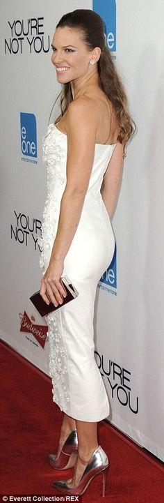 Glamming it up: She was a vision in a stunning white gown at the premiere of her new film, You're Not You, on Wednesday