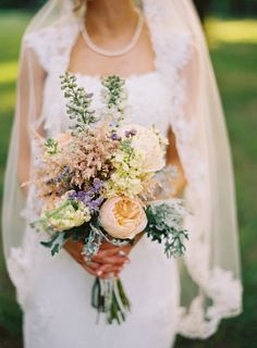 wildflower bouquets with pale pinks and creams, light blue and burlap and lace tied around.