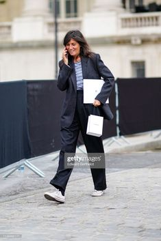 Emmanuelle Alt wears a dark grey jacket a blue and purple striped top black wide leg cuffed pants white sneakers outside the Chanel Cruise Collection. Black Denim Pants, Cuffed Pants, Emmanuelle Alt Style, Cruise Collection, Ootd, Chanel Black, Chanel Chanel, Trends, Fashion Pants