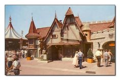 """The back of this postcard says """"One of FANTASYLAND'S stellar attractions-Merlin's Magic Shop. This unique shop brings to life the legend of King Arthur's eerie wizard-Merlin. Featured is legendary Excalibur pierced through solid stone. Unbelievable impromptu magic may be seen for amateur and professional use."""""""