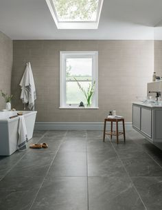 These extra-large tiles have been inspired by a rare type of Phyllite slate found in the Dalradian rocks on the Isle of Arran; expertly replicated by the newest printing technology, each tile has its own unique pattern with a smooth long-lasting finish. To evoke a calming atmosphere choose a coordinating tile that works in harmony with the delicate colour variations of the Penthouse range.
