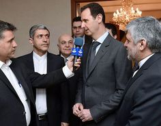 ダマスカスで、取材に応じるシリアのアサド大統領(中央)=16日、国営シリア・アラブ通信(SANA)提供(AFP=時事) ▼16Mar2015時事通信|内戦終結交渉、米の行動次第=外圧をけん制-シリア大統領 http://www.jiji.com/jc/zc?k=201503/2015031600815