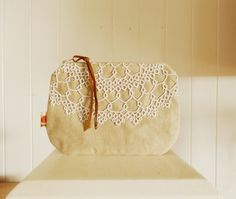 Vintage lace clutch purse / taupe zip purse upcycled clutch with tatted doily. $34.00, via Etsy.