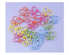 Butterfly Paper Clips...Something useful you can put into a V.T. card and yet light enough to mail.   -Penny-