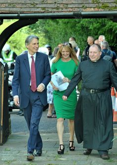 MP Phillip Hammond, wife Susan and vicar Tony Shutt at the service to remember Flight Lieutenant Robert Skene, who is thought to be one of the first people to die in an aircraft during the First World War
