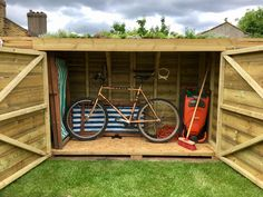 Bluum Bike Shed, now with plants in the green roof and a shed full of stuff in it!