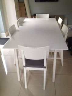 IKEA dinning table and chairs white is about 5 years old, very sturdy, but does have signs of wear