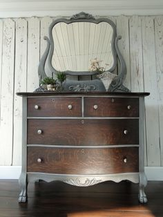 """""""Shade to Gray"""" This is an incredible old oak chest and tilt mirror. The woodgrain is not like anything you would find on something newly made. I dark stained the top and drawer fronts and painted the case to show off the beautiful carvings. I used a lot of shading on the painted parts, more than you can really see in the pictures. Modern Vintage Antique Dresser Redo, Tv On Dresser, Vintage Dressers, Vintage Chest Of Drawers, Dresser Ideas, Antique Bedroom Furniture, Oak Dresser, Antique Chest, Antique Paint"""