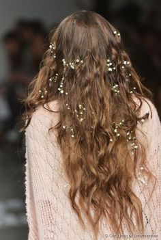 Models were seen with flowers in their hair on the Wildfox runway at Mercedes-Benz Fashion Week Fall/Winter '14 in New York