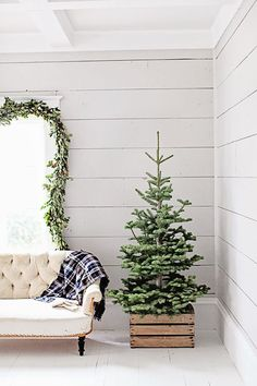 With minimal decor, a wooden crate christmas tree base lights up a room!