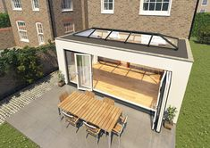 Flat roof extension with skylight & bifolding doors Garden Room Extensions, House Extensions, Kitchen Extensions, Orangery Roof, House Extension Design, Extension Ideas, Glass Roof Extension, Side Extension, Kitchen Diner Extension