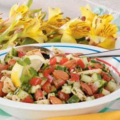 "Lemony Cucumber Salad Recipe -""In the summer, we use fresh cucumber and tomatoes from my husband's prolific garden for this colorful salad,"" writes field editor Marcia Severson of Hallock, Minnesota. ""it's oneof our favorite light suppers."""