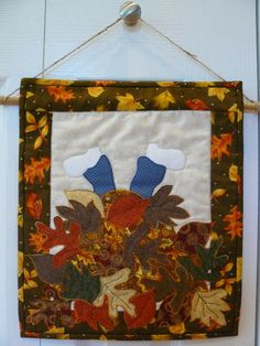 """scrapNsew1976 says: Adorable! Hang it on a wall or door at home or at the office. Hung with jute and wooden dowl that is tucked into a sleeve on the backside of the quilt. Quilt measures 12"""" x 14"""". When hanging by jute it hanges 18"""". This mini wall hanging was made with a pattern from Patch Abilities. - #quiltsyteam"""