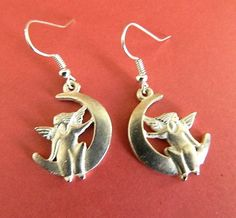 Matte  silver  tone  angels  on  crescent  moon  earrings | BellaWorxJewelry - Jewelry on ArtFire