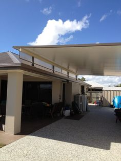 Stratco Cooldek Fly-over Carport with Twinwall side panels.