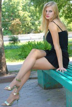 Slavic girl sitting on bench