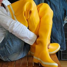 Yellow rubber thigh boots waders jeans