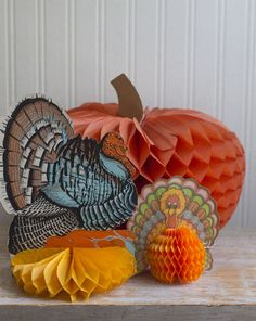 These vintage paper decorations include a pumpkin and 2 turkeys. Made by Beistle in the 1980's, they are 3d and have the honeycomb tissue paper bases. These add a touch of retro and kitsch to your hol