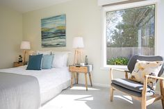 Master bedroom, blue bedroom, canvas abstract artwork above bed, timber lamps, timber side table, garden setting