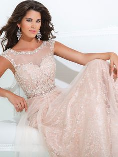 Everyone will take notice when you show up to your event wearing this gorgeous Tony Bowls Evenings prom dress. Lace and illusion are two of the Top fabrics for prom dresses in 2014. This Tony Bowls Evenings prom dress TBE11415 features a has a scoop neckline with sheer insets, gorgeous sweetheart beaded bodice, and a sheer back. A lace underskirt with a illusion flowing A-line overskirt completes this Tony Bowls Evenings prom dress. Elegance has never looked better than this striking Tony…