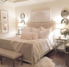 Similar set up, mirrors with dressers beneath, framed/artwork above