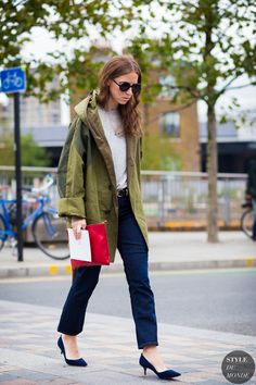 Mallory Schlau of Harper's Bazaar wears a white tshirt, jeans, a khaki jacket and navy pumps.