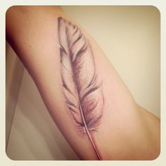 A white dove feather. Done by Lacie at Allied Ink, Vallejo.