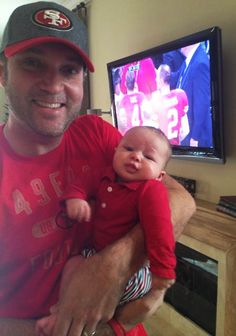 Adam, a 49ers fan, proudly showed off his son wearing a red shirt and striped pants on the day of Superbowl XLVII. Even though the 49ers lost, Aden definitely scored a touchdown with his outfit!