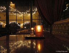 A romantically lit booth tucked away in the back at India Restaurant