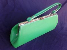 Hey, I found this really awesome Etsy listing at https://www.etsy.com/listing/222207922/cute-lime-green-60s-purse-vinyl-handbag