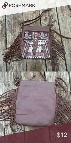 Crossbody fringe Cute design crossbody fringe bag. In good condition. Accessories
