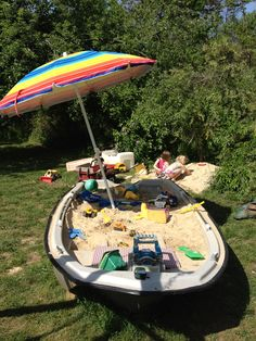 An old boat turned into a sand box.....my brother thought of this idea-genius!!!