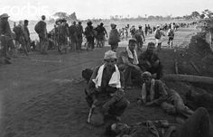 Bataan Death March - BE037206 - Rights Managed - Stock Photo - Corbis. Original caption:1945- American soldiers lying down at the beginning of what became the Bataan Death March.
