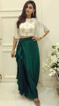 Cape Sleeve #Dhoti #Skirt has #Moti and #Stone Work. Striking Green Crop Top #Lehenga #Choli for Birthday Party is Satin dhoti Skirt and Georgette Top with Net #Dupatta.