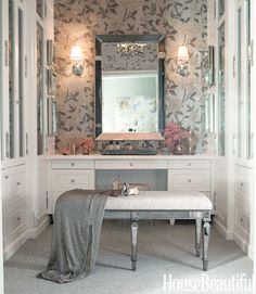 Schumacher's Whitney Floral wallpaper and a Venetian mirror give movie-star glamour to the dressing room. The bench was designed by McDonald.