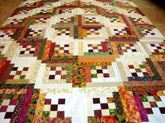 Barn raising log cabin quilt with nine patch centers