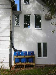 Inspiration for the stand I need to build for my three rain barrels.