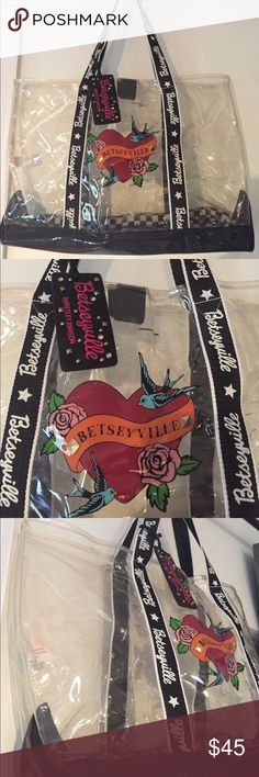 "BETSEYVILLE Clear Tote Bag Large Purse Beach Bag Clear large BETSEYVILLE Tote Bag by Betsey Johnson.  One large roomy interior with magnetic clasp.  Bottom is black and white checkered lining. The interior bottom rigid plastic piece does have some cracking! No tears in lining.  This is a previously used and loved Bag and has markings as pictured! In otherwise good condition.  Measures 20"" wide x 12"" tall x 6"" deep. Betsey Johnson Bags Totes"