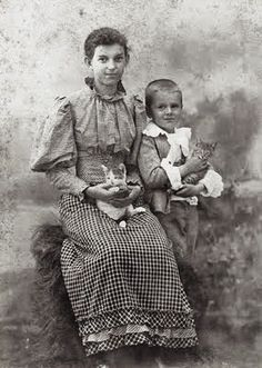 Woman, boy, and two kitties